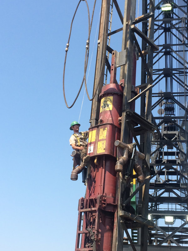 Man high up for pile driving.