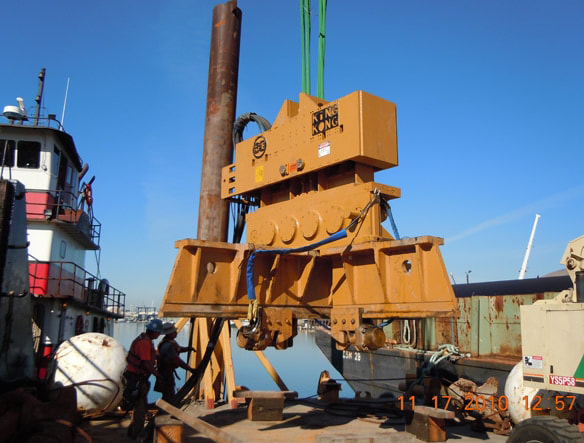 Pile driving mounting device.